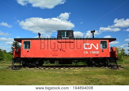 Vegreville Alberta,Canada,June 17th 2015.The end of the line for an old train caboose as it sits on display on the tracks in Vegreville Alberta.