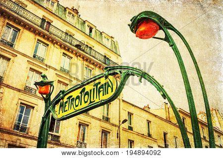 vintage textured picture of an art nouveau Metro sign in Paris France