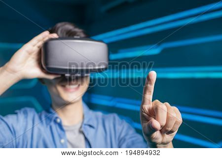 man wear vr and show something on the technology background