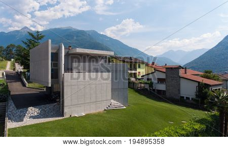 Modern villa contextualize in small town of Switzerland