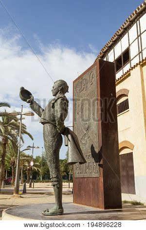 Lorca Spain - May 29 2017: Historic bullfight arena in Lorca with monument to the famous torero Pepin Jimenez. Province of Murcia Spain