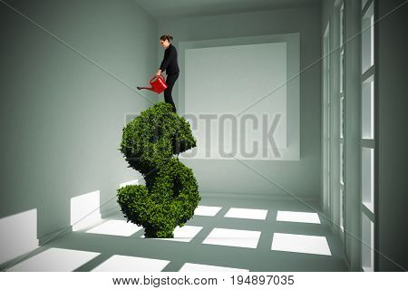 Businesswoman using red watering can against white room with square at wall