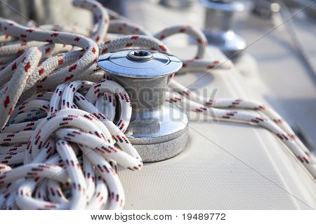 A close-up of a sail boat winch and bowline / yachting background