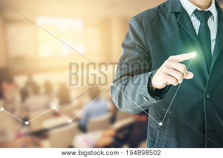 businessman hand touch virtual chart business Abstract blurred of conference hall or seminar room with attendee background.