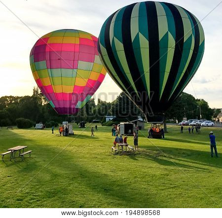 Two colorful hot air balloons have completed filling up and are ready to make their ascent on a beautiful Central Oregon morning in the summer.