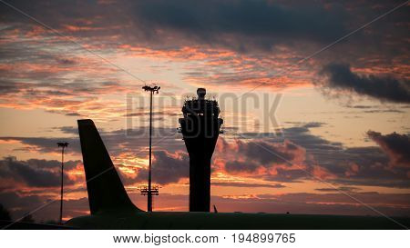 Sunset at International airport - control tower, telephoto