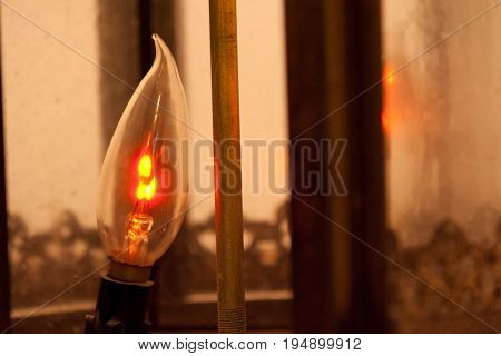 Flicker Light bulb with small filament inside lamp housing