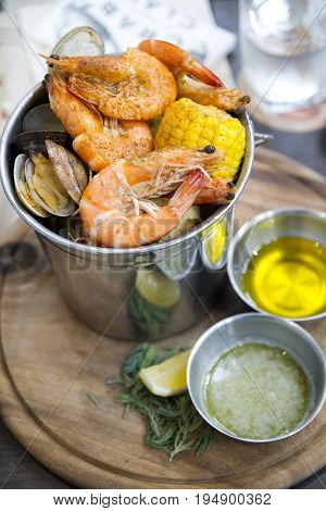 Manilla clam and shrimp  in the bucket