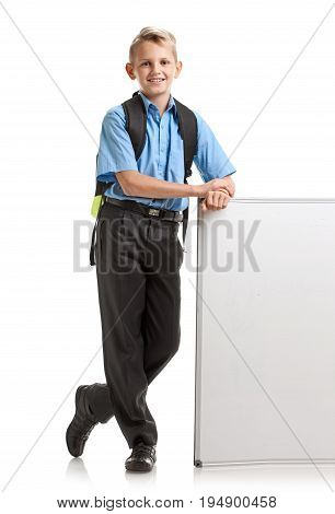 Portrait of happy smiling male pupil posing with whiteboard