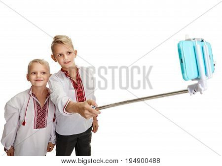 Two stylish ukrainian boys making photo with selfie stick