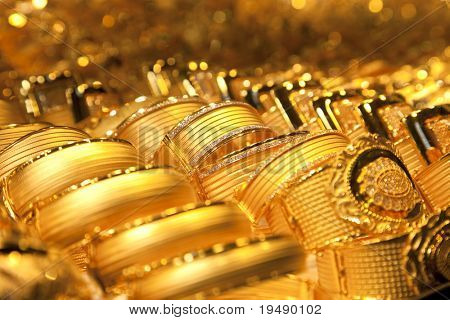 gold jewelry background / soft selective focus