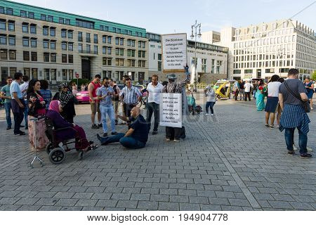 BERLIN - JULY 09 2017: A single protest action against Zionism on the Pariser Platz in front of the Brandenburg Gate.