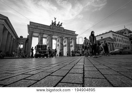 BERLIN - JULY 09 2017: The famous symbol of Berlin - Brandenburg vorotama and Pariser Platz. Black and white.