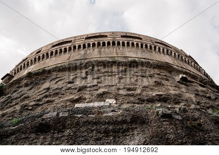 Rome Italy - August 19 2016: Low angle view of Mausoleum Castel Sant Angelo a cloudy summer day. The Mausoleum of Hadrian usually known as Castel Sant'Angelo is a towering cylindrical building in Rome
