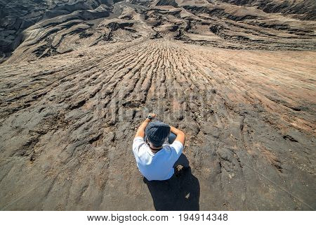 Man On Top Of Layer Volcanic Ash As Sand Ground Of Mount Bromo Volcano (gunung Bromo) At Bromo Tengg