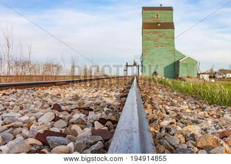 Steel Rails Leading to Old Wooden Grain Elevator