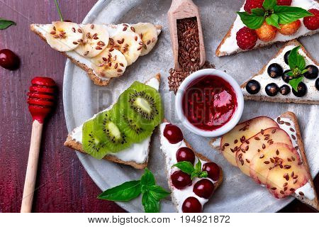 Fruit Toast On Red Background. Healthy Breakfast. Clean Eating. Dieting Concept. Grain Bread Slices