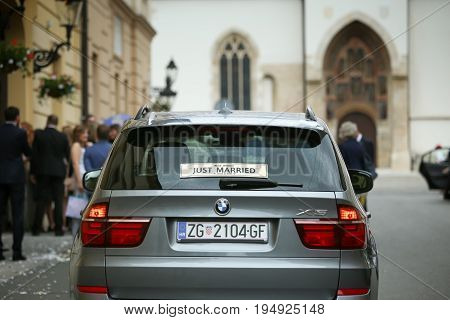 ZAGREB CROATIA - MAY 20 2017 : A Just Married sign on the back window of a parked car in Zagreb Croatia.