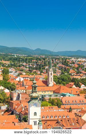 Zagreb center, aerial view, rooftops and church towers, Medvednica mountain in background poster