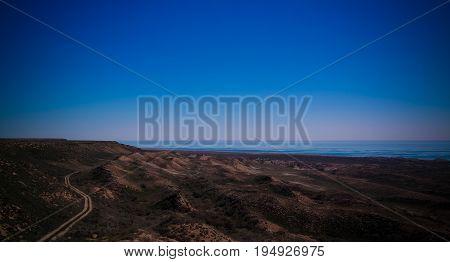 Panorama view to Aral sea from the rim of Plateau Ustyurt near Duana cape in Karakalpakstan Uzbekistan