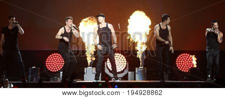 NEW YORK-JUL 7: (L-R) Jonathan Knight, Joey McIntyre, Donnie Wahlberg, Jordan Knight and Danny Wood of New Kids on the Block perform at NYCB Live on July 7, 2017 in Uniondale, New York.