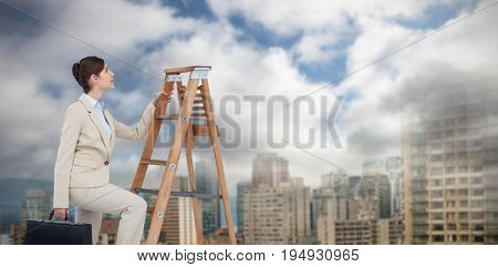 Businesswoman climbing career ladder with briefcase against towers in city