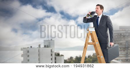 Businessman looking on a ladder against white buildings by sea