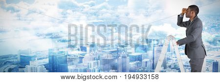 Businessman standing on ladder looking against view of crowded cityscape Aerial view of crowded cityscape