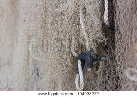 Old fishing net with floats and sinkers
