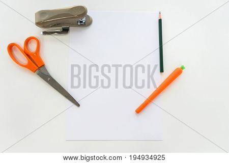 office stationary of mock up A4 paper sheet scissors pen pencil and stapler