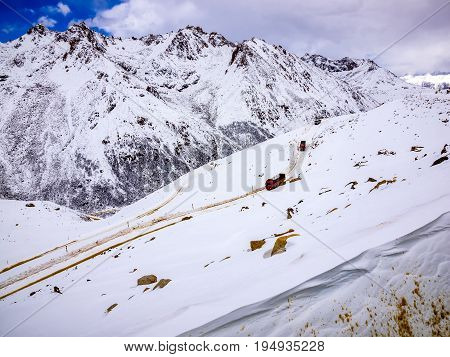 Transportation at the slippery and narrow highway on the top of Chola mountain in winter Sichuan China