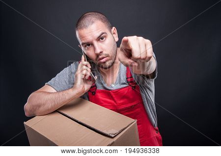 Mover Man Holding Box Talking At Phone Pointing Camera