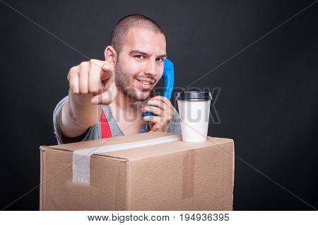 Mover Guy Talking On Phone Having Coffee Pointing Camera