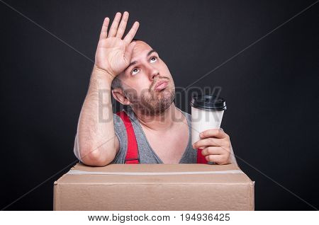 Tired Mover Guy Holding Takeaway Coffee Cup