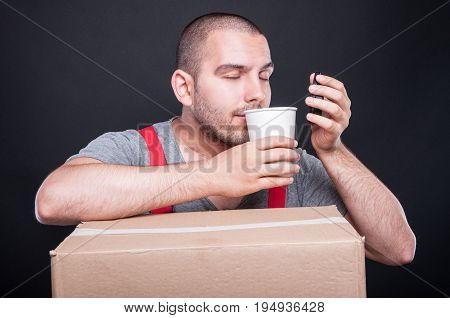 Mover Guy Smelling Coffee Having A Break