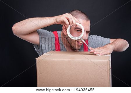 Mover Guy Packing Box With Duct Tape Being Playful