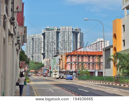 SINGAPORE - MAY 9, 2015: The junction of South Bridge Road with Upper Cross Street in Singapore's Chinatown. The big white buildings are actually public housing buildings called The Pinnacle@Duxton.