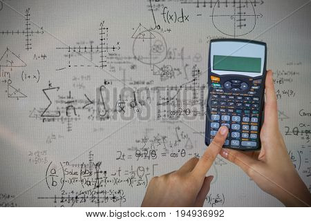 Hands of businesswoman using calculator against quadratic equations with solution
