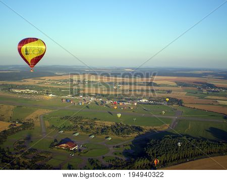 Hot air ballon over countryside and the air-base of Chambley, august 2007 5th