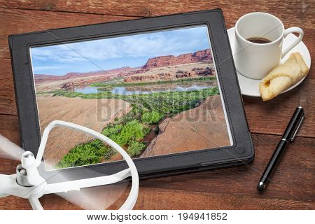 Colorado River canyon in the Moab area, Utah - reviewing and editing aerial image on a digital tablet,