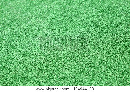 Green grass background. Artificial lawn. Green grass Carpet