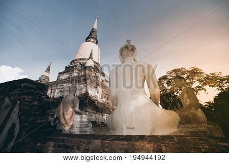 AYUTTHAYA,THAILAND-JULY 9,2017 : Buddha statues and ruined at Principal Chedi in Wat Yai Chai Mongkhon the Great Monastery of Auspicious Victory is located Ayutthaya Historical Park in Ayutthaya old capital city in Middle of Thailand.