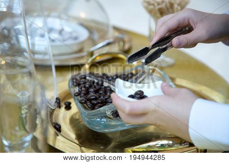 Woman's hand taking candies from  glass jar