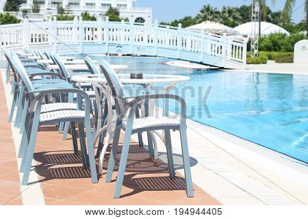 Outdoor table and chair near swimming pool