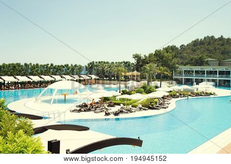 View of the swimming pool resort in Turkey in the summer during the holidays