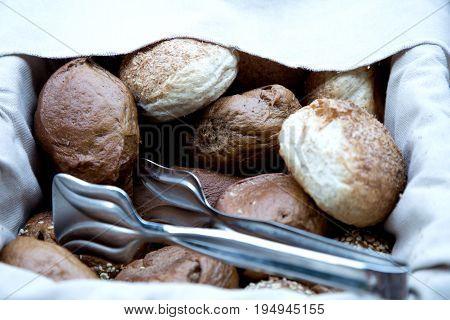 Bread rolls in a basket. Fresh bread
