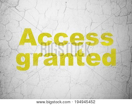 Safety concept: Yellow Access Granted on textured concrete wall background