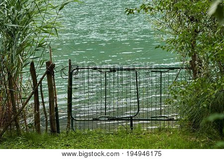 Weird and curious gate on the lake