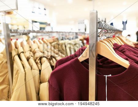 Clothes Hanging In The Railing Showing Size