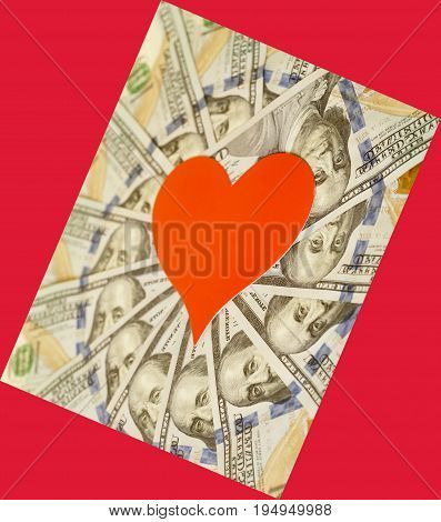 Red Paper Heart And Hundred Dollar Bills On Red